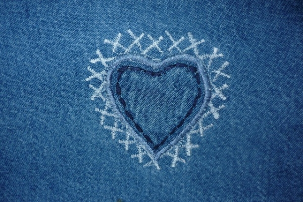 Heart on blue fabric